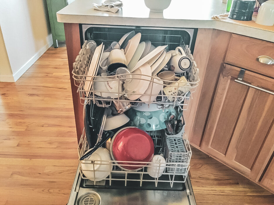 A dishwasher that has been loaded to be overly full