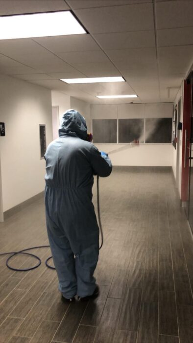 A worker spraying disinfection solution.