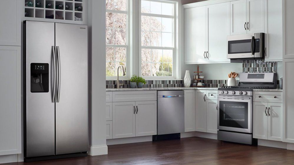 A picture of a kitchen with normal kitchen appliances